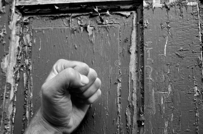 can-you-hear-me-knocking-black-white-fist-pounding-weathered-old-door-39995891